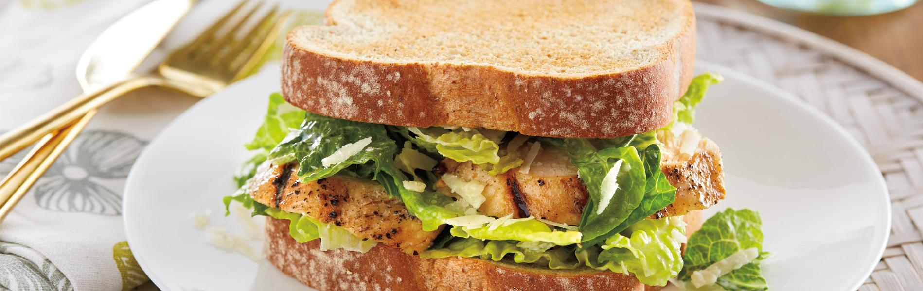 Caesar salad sandwich made with Artesano Golden Wheat Bread.