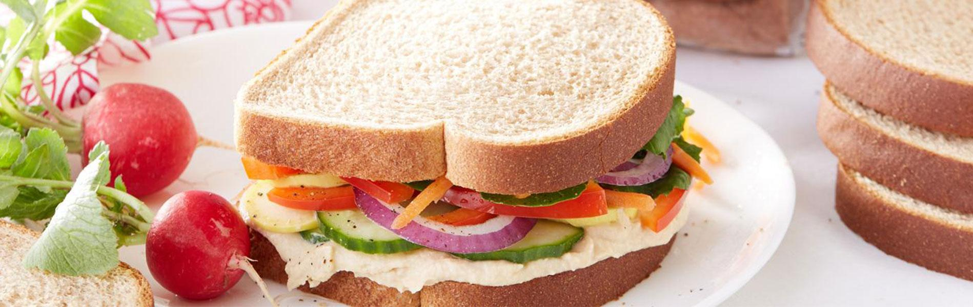 Hummus and Veggies sandwich made with Whole Wheat Bread