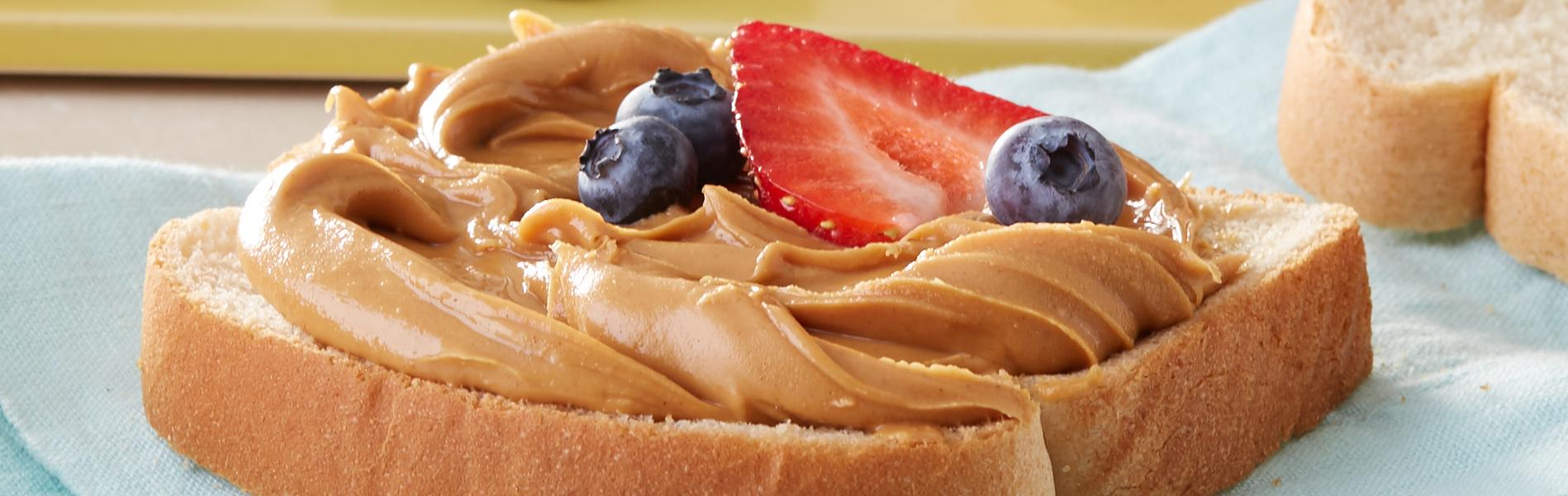 Peanut Butter and fruit on Classic White Bread