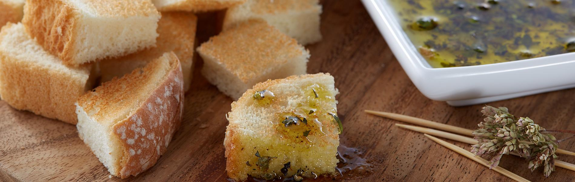 Cubed Artesano Bread serve with Italian Seasoning and Olive Oil