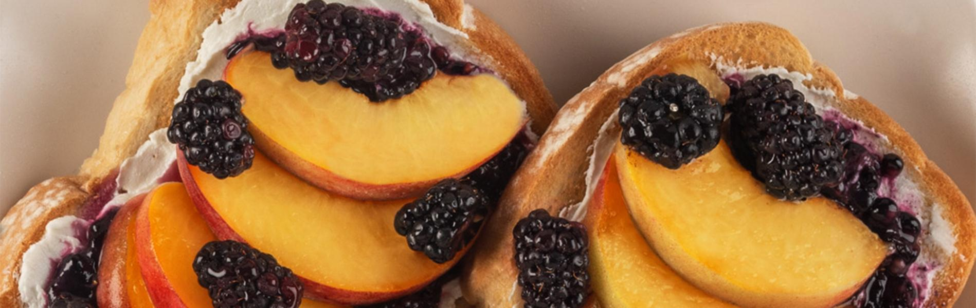 Toasted Sara Lee Artesano Bread with Goat cheese, fresh peaches and blackberries