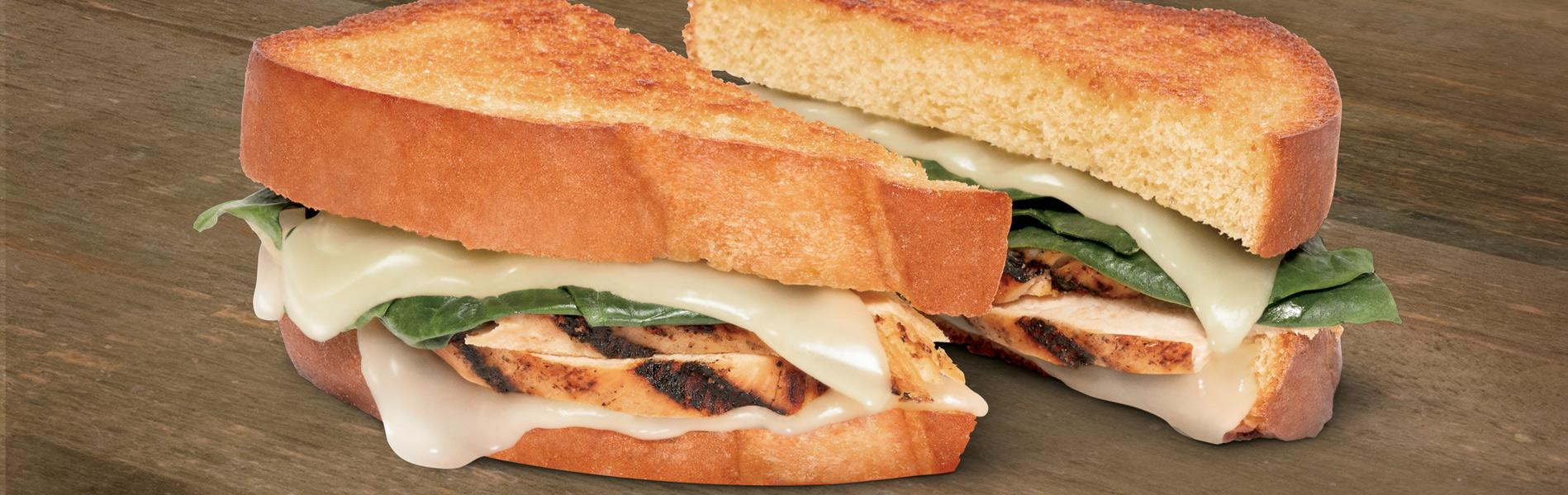 Grilled Cheese made with grilled chicken, mozzarella cheese and spinach, using Sara Lee® Artesano™ Potato Bread