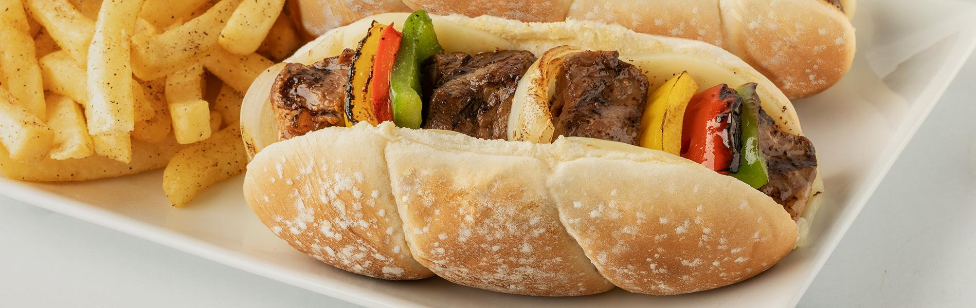 grilled steak, peppers and onions into grilled, Provolone-lined Sara Lee Artesano Sausage Rolls