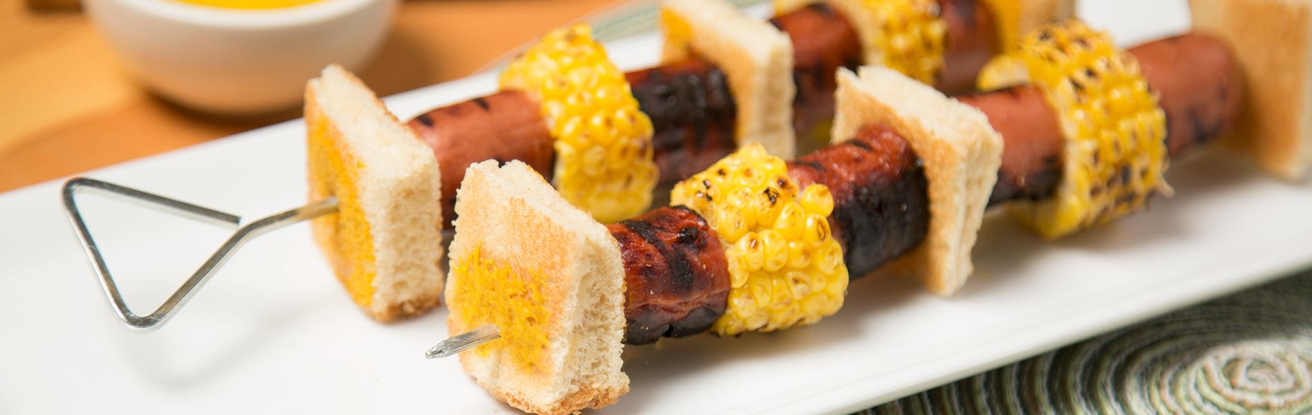 Grilled Hot Dog, Corn and bread on a skewer