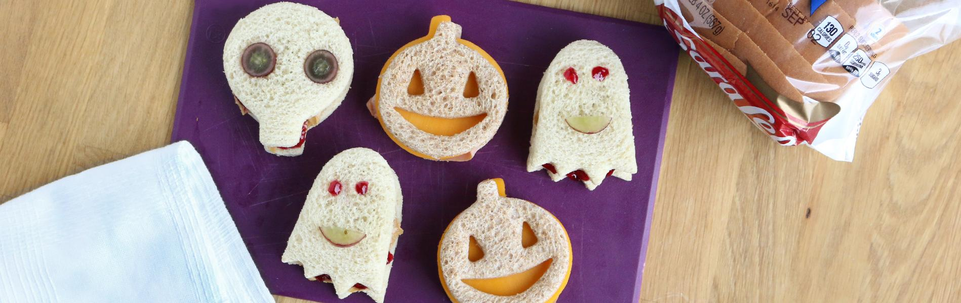 Assorted sandwiches shaped like ghosts, pumpkins and skulls