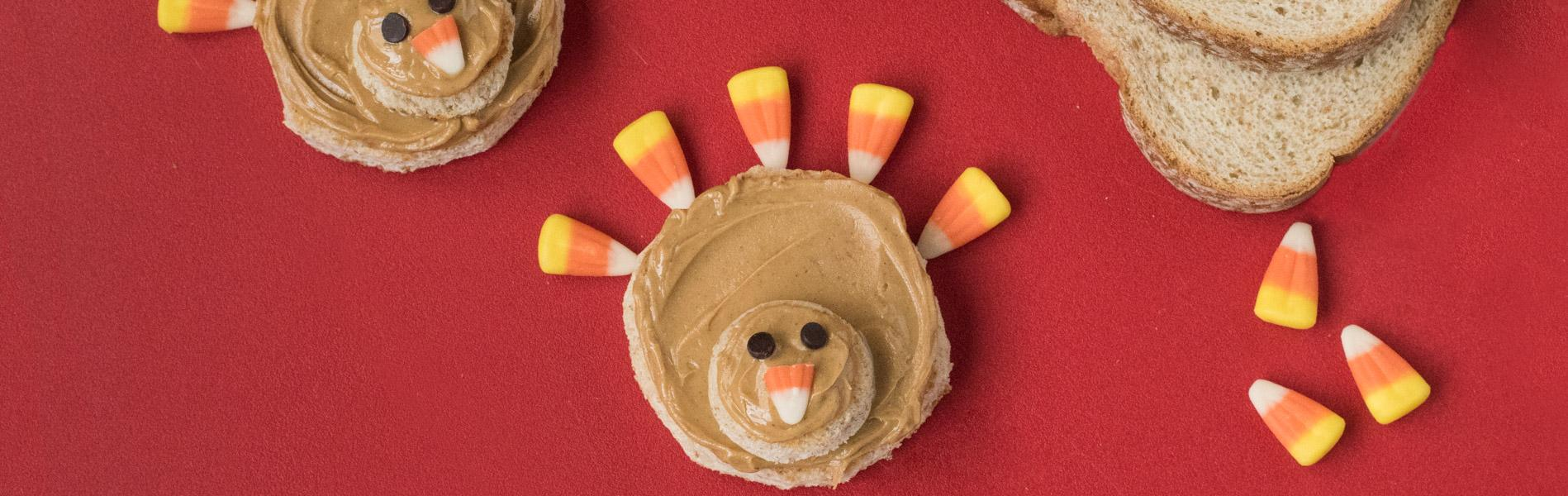 Turkey shaped, Peanut butter on a circular sandwich with candy corn to make a