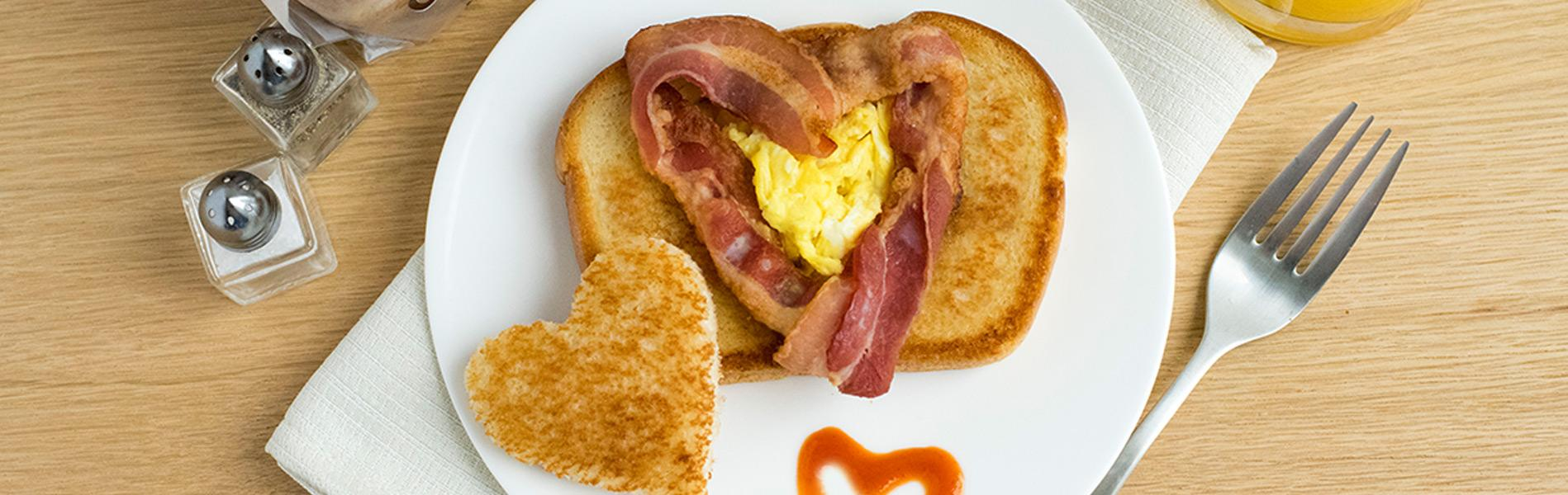Bacon and scrambled eggs on toast