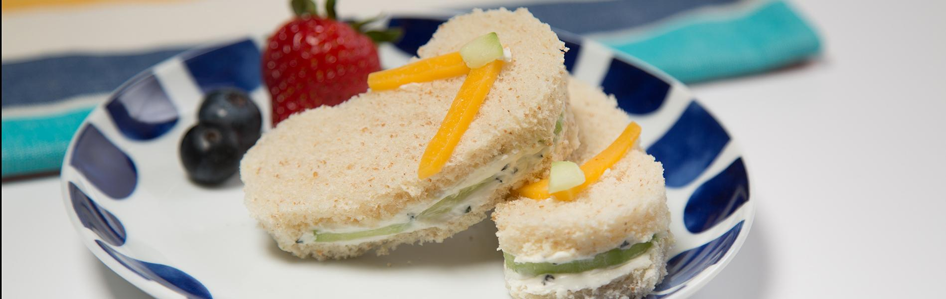 Cucumber and cream cheese sandwich shaped like sandals