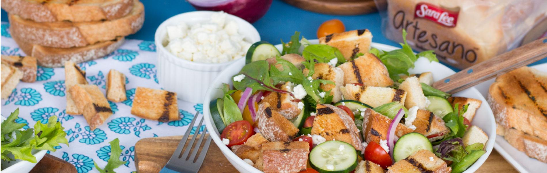 Greek salad with cubed bread