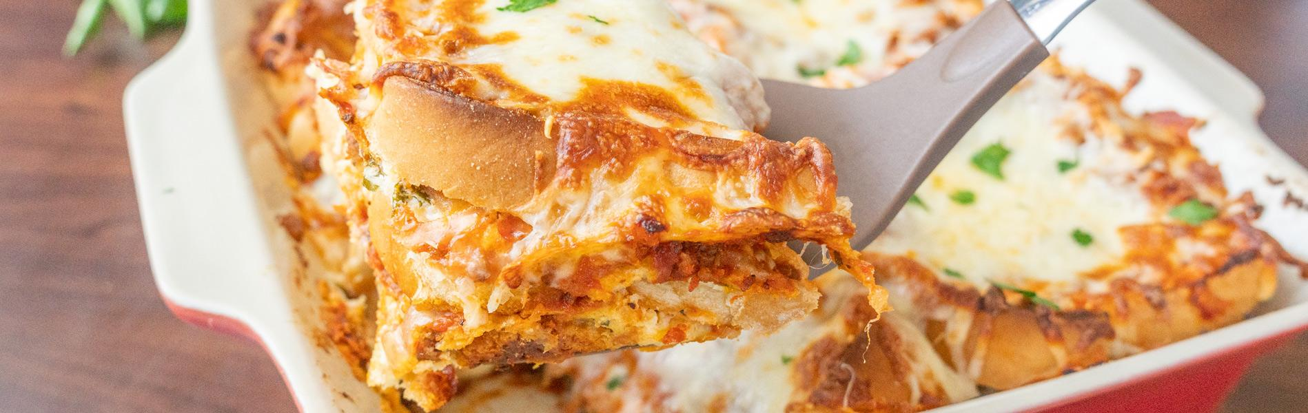 Lasagna made with bread slices, ground beef, Italian sausage, cheese and spices