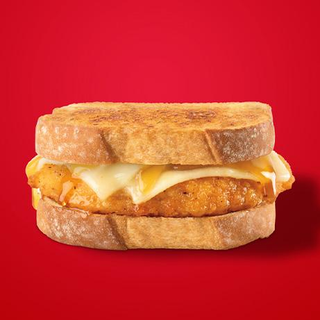 Chicken sandwich with hot honey and White Cheddar cheese on Artesano™ Maple & Brown Sugar Bread