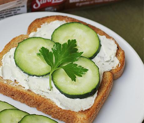Onion cream cheese topped with cucumbers on toast