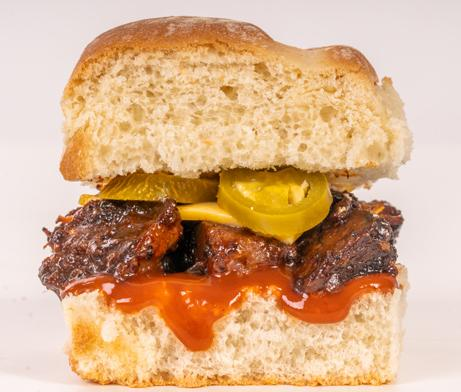 Brisket, cheese, BBQ sauce and jalapeños on a slider sandwich