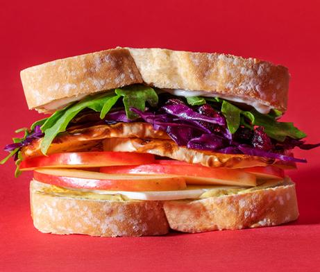 Sandwich with dried cranberries, red cabbage, butternut squash, honey crisp apples, White Cheddar cheese and dijon