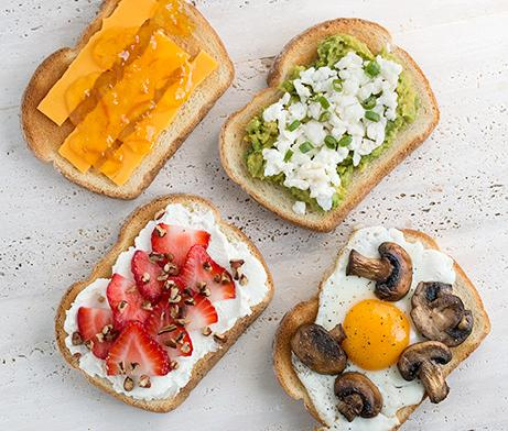 Toast made 4 ways - Avocado & Egg White, Cheddar Cheese & Marmalade, Ricotta Spread with Berries & Nuts and Mushrooms & Fried Egg