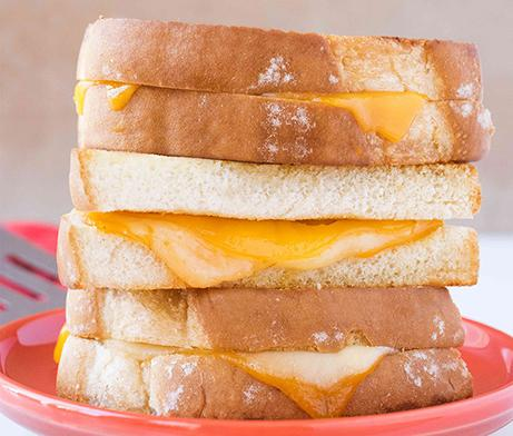 Two cheese and mayo grilled cheese sandwiches