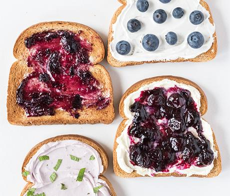 Toast bread with blueberry fruit, blueberry jelly, and cream cheese