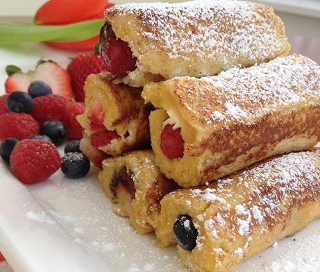 French Toast Rollups with fruit and variety of spread